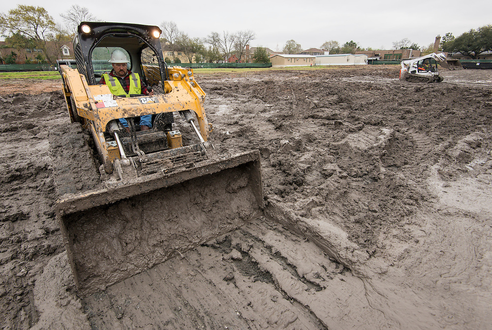 Construction workers prepare the site for the new Condit Elementary School, March 10, 2015.