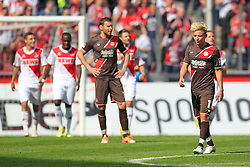 04.05.2014, Rhein-Energie Stadion, Koeln, GER, 2. FBL, 1. FC Koeln vs FC St. Pauli, 33. Runde, im Bild Marc Rzatkowski (FC Sankt Pauli #10) und Markus Thorandt (FC Sankt Pauli #16 - links) enttaeuscht nach dem Tor zum 3:0 durch Patrick Helmes (1. FC Koeln #16) // during the German 2nd Bundesliga 33th round match between 1. FC Cologne and FC St Pauli at the Rhein-Energie Stadion in Koeln, Germany on 2014/05/04. EXPA Pictures © 2014, PhotoCredit: EXPA/ Eibner-Pressefoto/ Schueler<br /> <br /> *****ATTENTION - OUT of GER*****