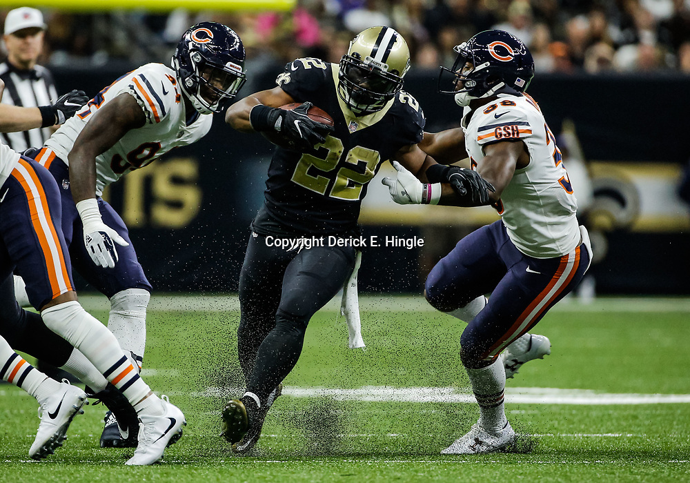 Oct 29, 2017; New Orleans, LA, USA; New Orleans Saints running back Mark Ingram (22) runs past Chicago Bears linebacker Leonard Floyd (94) and safety Adrian Amos (38) during the first half of a game at the Mercedes-Benz Superdome. Mandatory Credit: Derick E. Hingle-USA TODAY Sports