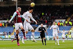 Ki Sung-Yeung of Swansea City wins a header - Photo mandatory by-line: Matt McNulty/JMP - Mobile: 07966 386802 - 28/02/2015 - SPORT - Football - Burnley - Turf Moor - Burnley v Swansea City - Barclays Premier League