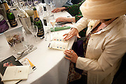 SPIRITUAL HEALER; INGRID COLLINS RESEARCHING THE HORSES. Fashion shows in the Besborough Restaurant during Ascot week. Ascot. Tuesday 16 June 2009.