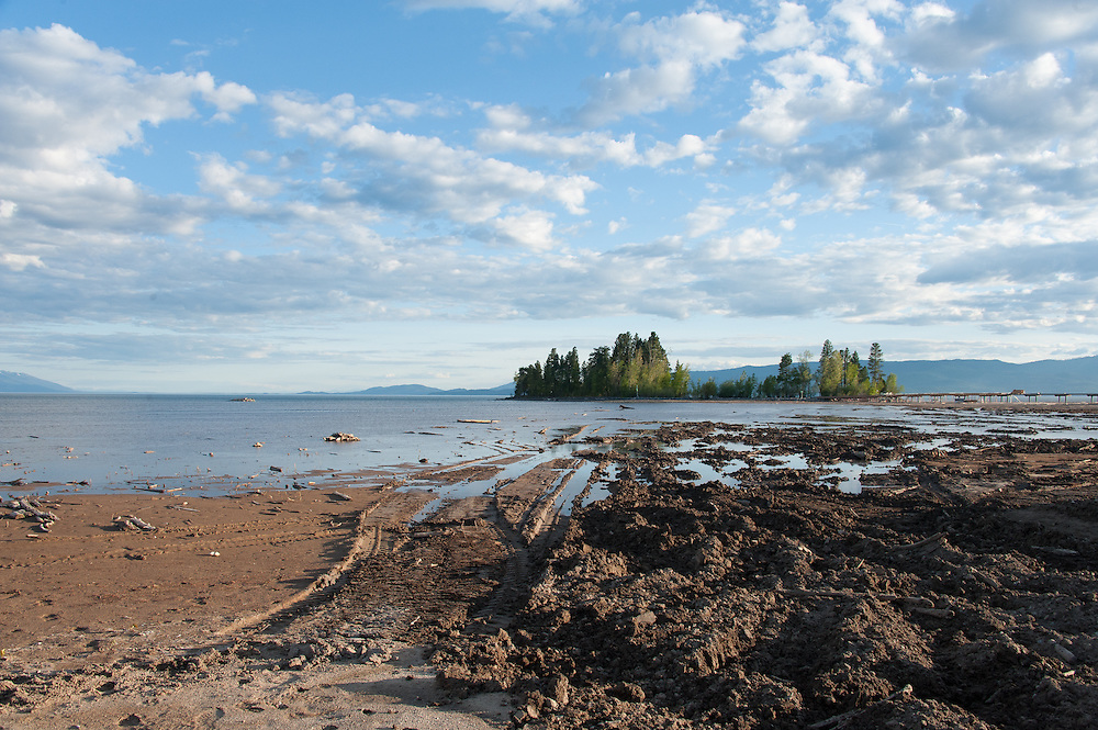 Looking south across Flathead Lake past Dockstader Island where the bridge terminates.   Destruction of the lakebed and the resulting loss of scenic value to the area caused by construction of a private bridge to Dockstader Island on the north shore of Flathead Lake in Bigfork, Montana, in violation of the state's Lakeshore Protection Act, as photographed on May 20, 2015.