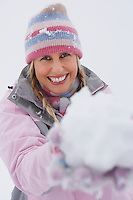 Woman holding snowball portrait