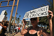 "Maggie Smith, (left, along with about 1,000 demonstrators, participates in Occupy Tucson at Military Plaza in Armory Park, Tucson, Arizona, USA.  The Occupy Tucson organizers created the movement in solidarity with the Occupy Wall Street movement in New York and the Occupy Together movement across the USA. ..The leaders of this movement are the everyday people participating in a movement with many de-centralized goals, with an over-arching theme of protesting government corruption from corporate money and national income disparity. We use a tool called the ""General Assembly"" to facilitate open, participatory and horizontal organizing between members of the public. We welcome people from all colors, genders and beliefs to participate in our movement. .."