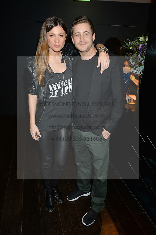 MARTINA SPUZEVIC and TYRONE WOOD at the Launch Of Osman Yousefzada's 'The Collective' 4th edition with special guest collaborator Poppy Delevingne held in the Rumpus Room at The Mondrian Hotel, 19 Upper Ground, London SE1 on 24th November 2014, sponsored by Storm models and Beluga vodka.