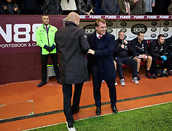 BURNLEY, ENGLAND - Boxing Day, Friday, December 26, 2014: Liverpool's manager Brendan Rodgers and Burnley's manager Sean Dyche during the Premier League match at Turf Moor. (Pic by David Rawcliffe/Propaganda)
