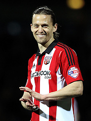 Lasse Vibe of Brentford smiles and claps as the Bolton Wanderers fans chant songs at him - Mandatory by-line: Robbie Stephenson/JMP - 05/04/2016 - FOOTBALL - Griffin Park - Brentford, England - Brentford v Bolton Wanderers - Sky Bet Championship
