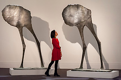 "© Licensed to London News Pictures. 18/11/2016. London, UK. A staff member views ""Mirage II"" by Dame Elisabeth Frink (est. GBP120-180k)"", at the preview at Sotheby's of works on view at four upcoming November auctions featuring Modern & Post-War British Art, A Painter's Paradise (Julian Trevelyan & Mary Fedden at Durham Wharf), Scottish Art and Picasso Ceramics from the Lord & Lady Attenborough Private Collection. Photo credit : Stephen Chung/LNP"