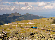 Looking north from the top of Mt. Washington including the Mt. Washington Cog Railway train, Sargent's Purchase, New Hampshire, USA.