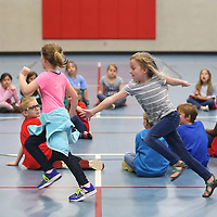 Lauren Wood | Buy at photos.djournal.com<br /> Chloe Hill, 7, left, runs as Meg Martin, 7, reaches out to tag her while playing a game of 'duck, duck, goose' with other Mooreville Elementary first graders during their visit at the ICC-Fulton campus.