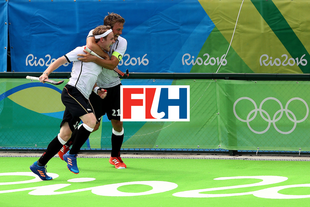 RIO DE JANEIRO, BRAZIL - AUGUST 08:  Christopher Ruhr #17 and Moritz Furste #21 of Germany celebrate a goal against India during a Men's Pool B match on Day 3 of the Rio 2016 Olympic Games at the Olympic Hockey Centre on August 8, 2016 in Rio de Janeiro, Brazil.  (Photo by Sean M. Haffey/Getty Images)