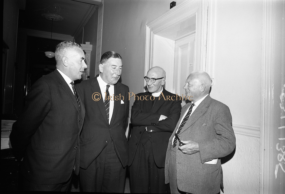Annual General meeting of the Irish Rugby Football Union at the Shelbourne Hotel, Dublin. W.J. O'Brien, Hon. Sec. Munster Branch; Rev. Fr. F.G. Guinane, S. J. Munster Branch; and D.F. O'Connell, Munster Branch.<br /> 25.06.1965