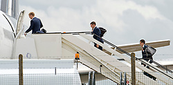 © London News Pictures. 06/06/2012. Luton, UK.  England players Joe Hart (left) James Milner (centre) and Stuart Downing (right) boarding a plane at Luton Airport in Bedfordshire on June 6, 2012 to head to Poland for the Euro 2012 football tournament. The squads training camp is based in Krakow.  Photo credit: Ben Cawthra/LNP