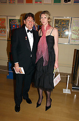 JOHN MADEJSKI and CAMILLA MORRIS at The Royal Academy dinner before the official opening of the Summer Exhibition held at the Royal Academy of Art, Burlington House, Piccadilly, London W1 on 6th June 2006.<br />