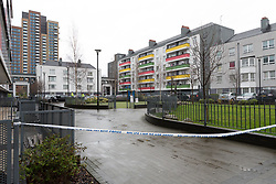© Licensed to London News Pictures. 02/04/2018. London, UK. The crime scene on the estate behind a parade of shops on the A12 in Bromley by Bow, E3 where a teenager was stabbed last night at around 6:05pm. A 16 year old boy suffering stabbing injuries and also a further victim were taken to an east London hospital by London Ambulance staff. The teenage victim remains in a critical condition this morning. Photo credit: Vickie Flores/LNP