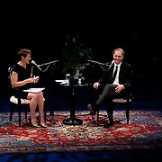 Author Dan Brown speaks with NHPR's Virginia Prescott during a Writers on a New England Stage benefit show at The Music Hall in Portsmouth, NH