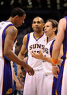 Mar. 12, 2012; Phoenix, AZ, USA; Phoenix Suns guard Steve Nash (13) talks with teammates forward Channing Frye (8) and forward Grant Hill (33) on the court while playing against the Minnesota Timberwolves at the US Airways Center. The Timberwolves defeated the Suns 127-124. Mandatory Credit: Jennifer Stewart-US PRESSWIRE...