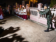 25 MARCH 2016 - BANGKOK, THAILAND: A Thai soldier photographs the crowd during Good Friday observances at Santa Cruz Church in Bangkok. Santa Cruz was one of the first Catholic churches established in Bangkok. It was built in the late 1700s by Portuguese soldiers allied with King Taksin the Great in his battles against the Burmese who invaded Thailand (then Siam). There are about 300,000 Catholics in Thailand, in 10 dioceses with 436 parishes. Good Friday marks the day Jesus Christ was crucified by the Romans and is one of the most important days in Catholicism and Christianity.      PHOTO BY JACK KURTZ