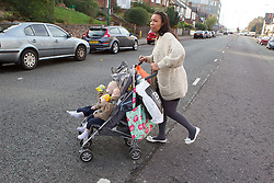 Mother crossing road with twins in buggy. (This photo has extra clearance covering Homelessness, Mental Health Issues, Bullying, Education and Exclusion, as well as the usual clearance for Fostering & Adoption and general Social Services contexts,)