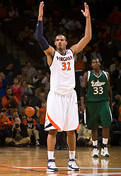 Virginia forward Mike Scott (32) fires the crowd up.  The Virginia Cavaliers defeated the South Florida Bulls 77-75 at the University of Virginia's John Paul Jones Arena in Charlottesville, VA on November 19, 2008.