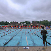 Swimmer Bryan Byrd (14), (RIGHT) prepares to take a practice swim during the Summer Swim league championships finials Saturday, July. 17, 2015 at Western YMCA in Wilmington, DEL