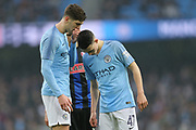 5 John Stones gives some quiet advice to 47 Phil Foden for Manchester City during the The FA Cup 3rd round match between Manchester City and Rotherham United at the Etihad Stadium, Manchester, England on 6 January 2019.