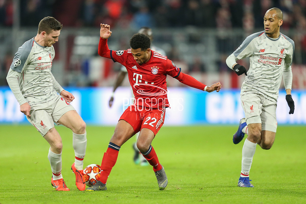 Liverpool defender Andrew Robertson (26) tackles Bayern Munich midfielder Serge Gnabry (22) during the Champions League match between Bayern Munich and Liverpool at the Allianz Arena, Munich, Germany, on 13 March 2019.