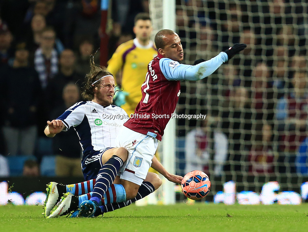 7th March 2015 - FA Cup 6th Round - Aston Villa v West Bromwich Albion - Gabriel Agbonlahor of Aston Villa goes down after being clattered by Jonas Olsson of West Bromwich Albion - Photo: Paul Roberts / Offside.
