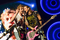 © Licensed to London News Pictures. 24/04/2014. London, UK.   McBusted performing live at The O2 Arena.   *** LICENSE CONDITIONS USAGE ALLOWED ONLY UNTIL 14 MAY 2014, NO USAGE BEYOND THAT DATE***.  In this picture - James Bourne (left), Dougie Poynter (right).  McBusted are an English pop-rock group composed of members of the bands Busted & McFly - James Bourne, Tony Fletcher, Danny Jones, Harry Judd, Dougie Poynter, and Matt Willis.  The only member of the original groups not participating in the new lineup is former Busted singer CharlieSimpson. Photo credit : Richard Isaac/LNP