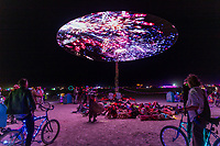Paraluna<br /> by: Christopher Schardt<br /> from: Oakland, CA<br /> year: 2019<br /> <br /> Paraluna is a giant, spinning disc of LEDs. Classical music plays from speakers on the ground while complementary animated patterns are displayed on the disc above. The disc is held up by a boom lift, allowing the disc to be raised, lowered, and tilted, to dramatic effect.<br /> <br /> URL: http://ledlabs.co/paraluna<br /> Contact: paraluna_bman@ledlabs.co<br /> <br /> <br /> https://burningman.org/event/brc/2019-art-installations/?yyyy=&aq=paraluna#a2I0V000001AVlcUAG