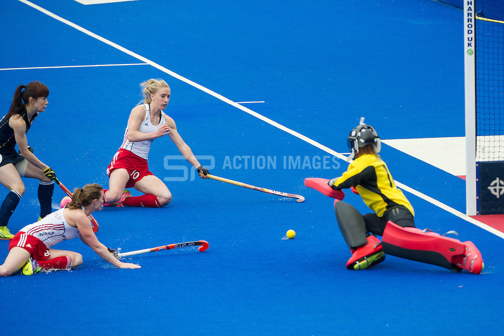 Great Britain's Susie Gilbert slides in to score at the far post. Great Britain v Japan - Schools Event, Lee Valley Hockey & Tennis Centre, London, UK on 27 April 2015. Photo: Simon Parker