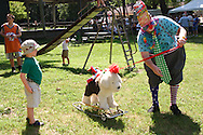 Joe Robinson of Dayton (right) tosses a stick for his dog to fetch during the Polish Summer Fest at the Polish Picnic Ground in Dayton, Sunday, July 31, 2011. Robinson says he's had offers from people at events he's done for the dog, but it's not for sale.
