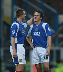 PORTSMOUTH, ENGLAND - SATURDAY, DECEMBER 9th, 2006: Matthew Taylor and Sean Davis of Portsmouth against Everton during the Premiership match at Fratton Park. (Pic by Chris Ratcliffe/Propaganda)
