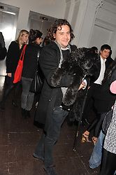 ADAM WAYMOUTH and his dog Jango at a party to celebrate the launch of the new gallery Pace at 6 Burlington Gardens, London on 3rd October 2012.