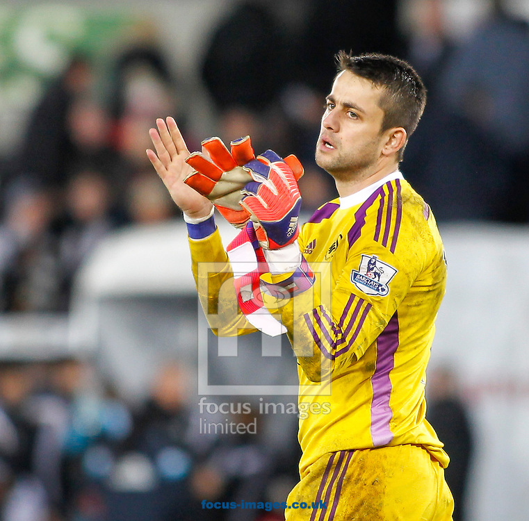 Lukasz Fabianski applauds to the Swansea City fans after the Barclays Premier League match at the Liberty Stadium, Swansea<br /> Picture by Mike Griffiths/Focus Images Ltd +44 7766 223933<br /> 17/01/2015