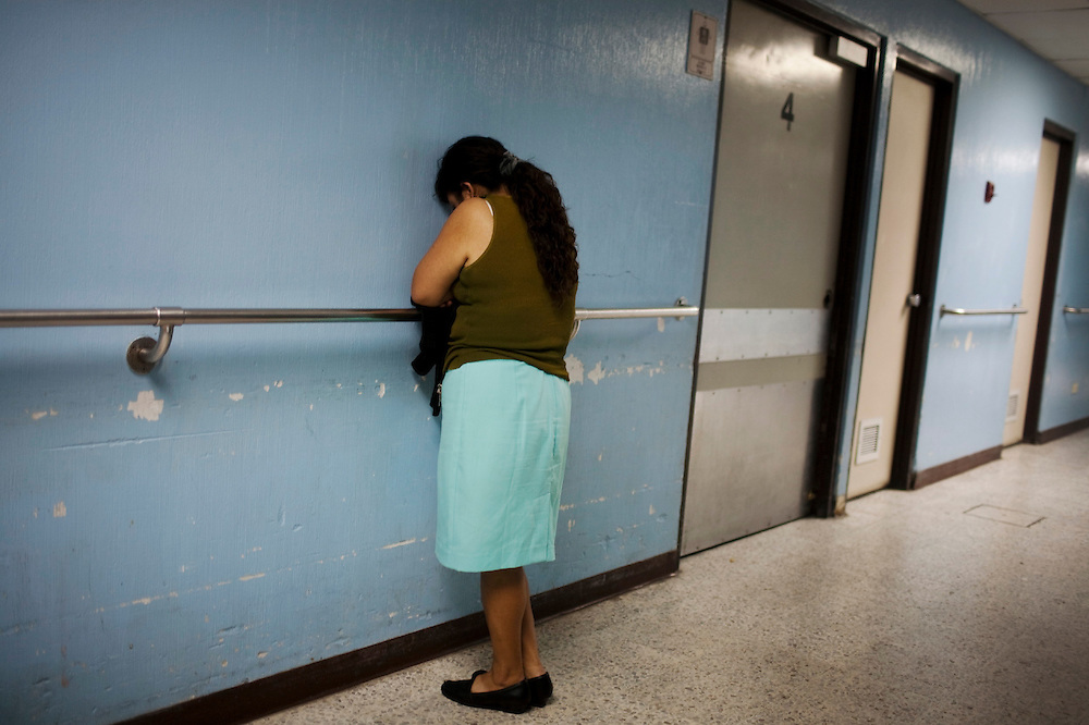 A woman who was wounded in her face after being attacked by her husband waits to take x-rays in emergency room of the San Juan de Dios hospital, Guatemala City, Monday, Nov. 22, 2010. (AP Photo/Rodrigo Abd)