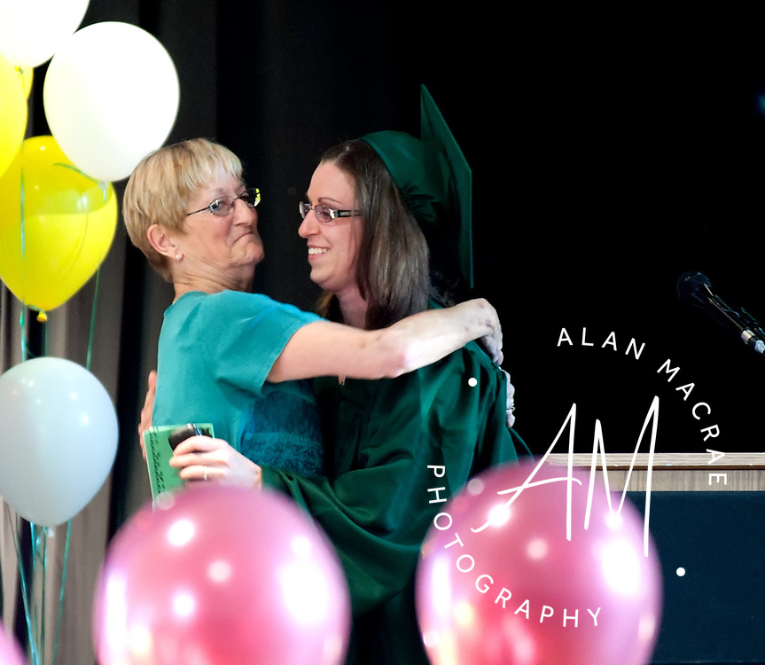 Franklin Adult Education Director Margaret Edgecomb gives a hug to graduate Dana Adler during commencement exercises at Franklin High School on Thursday, June 17, 2010.  (Alan MacRae/for the Citizen)