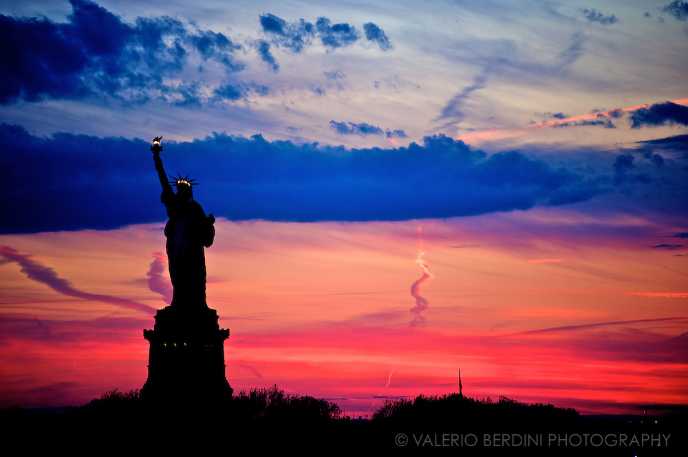 Sunset behind the Statue of Liberty on the way to Staten Island. New York City, USA.<br /> <br /> This photo is part of a personal portfolio on B&amp;H Photo http://www.bhphotovideo.com/explora/valerio-berdini