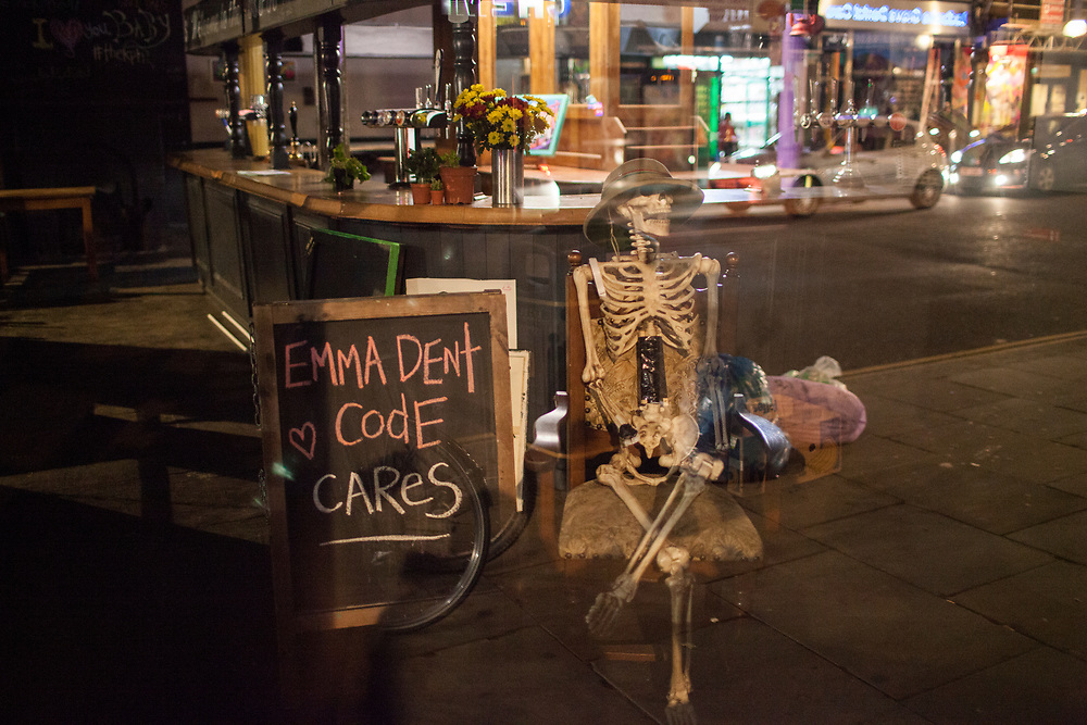 A Skeleton sits in the empty bar next to a sign that reads 'Emma Dent Coad cares'. Emma is the newly elected Labour MP for Kensington and Chelsea. 9th June 2017. The KPH pub. Ladbroke Grove. London.<br /> <br /> Photo- Zute Lightfoot