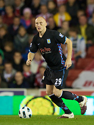 STOKE, ENGLAND - Monday, September 13, 2010: Aston Villa's James Collins in action against Stoke City during the Premiership match at the Britannia Stadium. (Photo by David Rawcliffe/Propaganda)