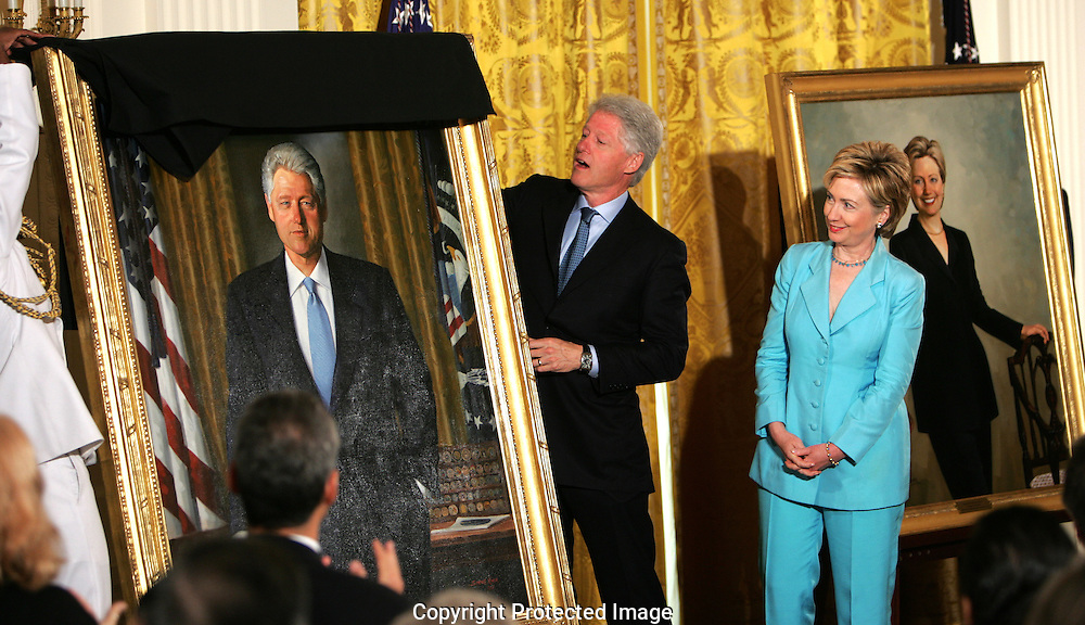 A 23MG IMAGE OF:..President and Senator Hillary Rodham Clinton at the unveiling of their official White House portraits in the East Room of the White House.  The portraits are the work of  painter Simmie Knox. Photo by Dennis Brack