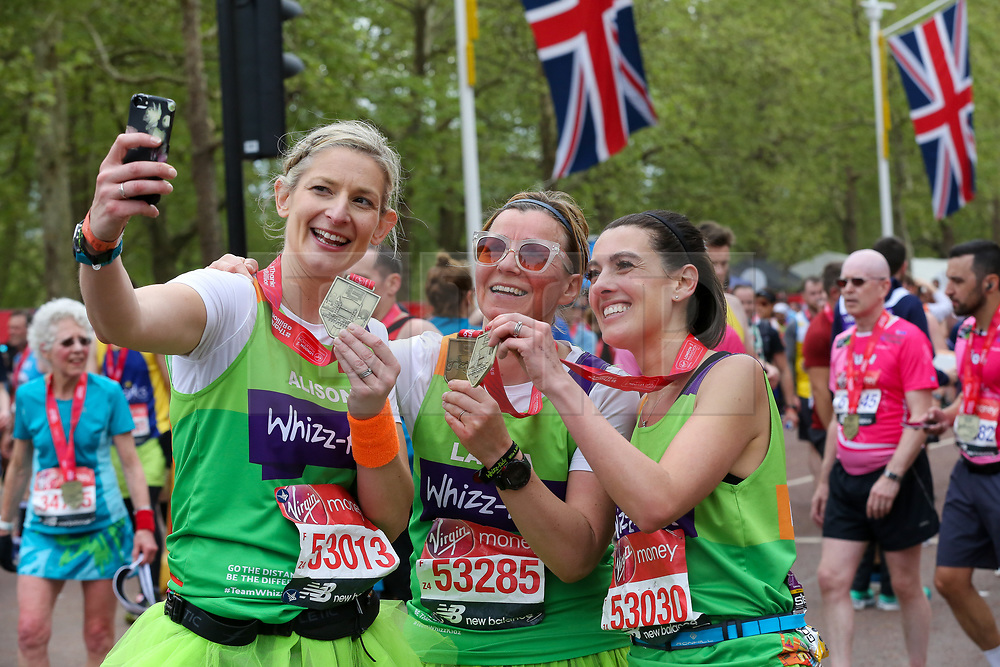 © Licensed to London News Pictures. 28/04/2019. London, UK. Runners take a selfie after completing the 2019 Virgin Money London Marathon. Photo credit: Dinendra Haria/LNP