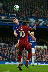 LIVERPOOL, ENGLAND - Sunday, March 3, 2019: Everton's Michael Keane (L) challenges Liverpool's Sadio Mane during the FA Premier League match between Everton FC and Liverpool FC, the 233rd Merseyside Derby, at Goodison Park. (Pic by Laura Malkin/Propaganda)