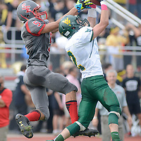 Laura Stoecker/lstoecker@dailyherald.com<br /> Waubonsie Valley's Brock Westwood intercepts a pass in the end zone to South Elgin's Tyler Christensen preventing a touchdown in the final seconds of the first quarter on Saturday, October 5.