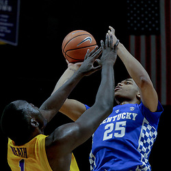 Jan 3, 2018; Baton Rouge, LA, USA; Kentucky Wildcats forward PJ Washington (25) shoots over LSU Tigers forward Duop Reath (1) during the first half at the Pete Maravich Assembly Center. Mandatory Credit: Derick E. Hingle-USA TODAY Sports