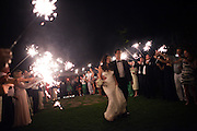 Ariana Rockefeller and her husband Matthew Bucklin exit their wedding reception through crowd of sparklers on Saturday, September 4, 2010.  Craig Dilger for The New York Times