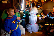 Genesis and Jason help dress the kids in their Halloween costumes to go trick-or-treating. The couple stretched their limited resources to make sure the kids could still enjoy normal kid activities during the stressful time of looking for a new home because of an order given to all the residents of their trailer court.