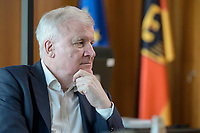 01 JUL 2019, BERLIN/GERMANY:<br /> Horst Seehofer, CSU, Bundesinnenminister, waehrend einem Interview, in seinem Buero, Bundesministerium des Inneren<br /> IMAGE: 20190701-01-051<br /> KEYWORDS: Büro