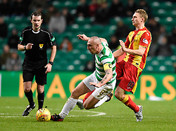 Celtic's Scott Brown is brought down by Partick's Chris Erskine during the Scottish Premiership match at Celtic Park, Glasgow.