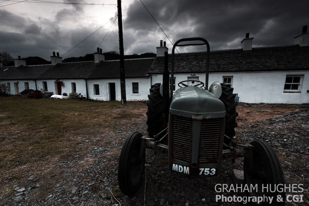 Old tractor outside cottages at Easdale Island in Scotland UK